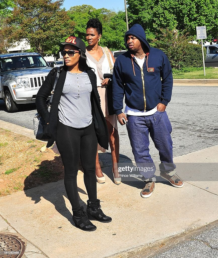 Erica Dixon, Mama Dee and <a gi-track='captionPersonalityLinkClicked' href=/galleries/search?phrase=Lil+Scrappy&family=editorial&specificpeople=775495 ng-click='$event.stopPropagation()'>Lil Scrappy</a> <a gi-track='captionPersonalityLinkClicked' href=/galleries/search?phrase=Lil+Scrappy&family=editorial&specificpeople=775495 ng-click='$event.stopPropagation()'>Lil Scrappy</a> Turns Himself In at Atlanta Police Department on April 23, 2013 in Atlanta, Georgia.
