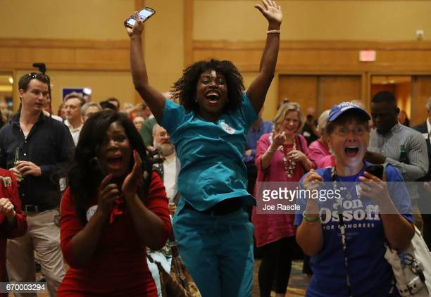 Erica Ferguson and other supporters react as early return numbers show that Democratic candidate Jon Ossoff is in the early lead for Georgia's 6th...
