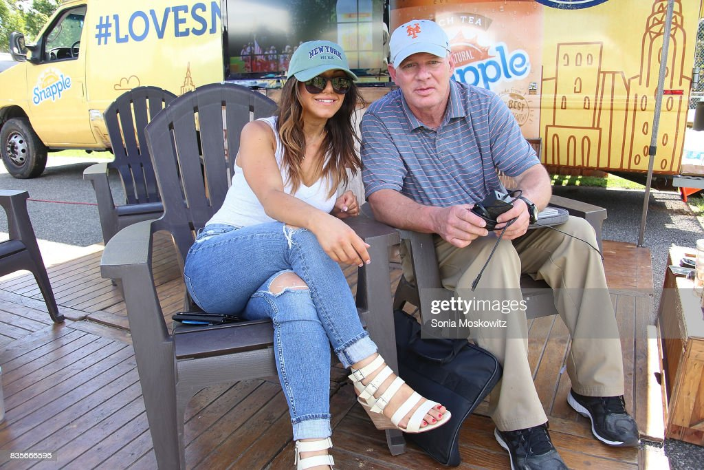 Erica Giuliani and Lenny Dykstra attend the 69th Annual Artists and Writers Softball Game at Herrick Park on August 19, 2017 in East Hampton, New York.