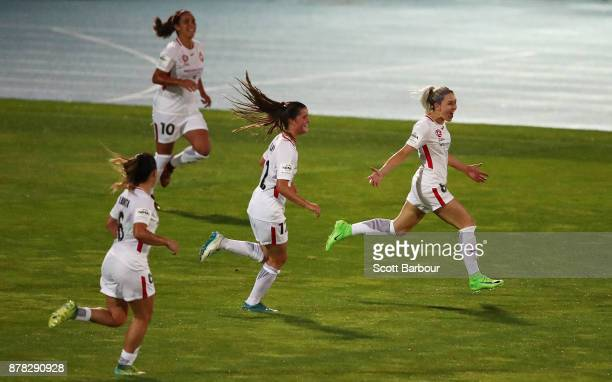 Erica Halloway of the Wanderers is congratulated by her teammates after scoring a goal during the round eight WLeague match between the Melbourne...