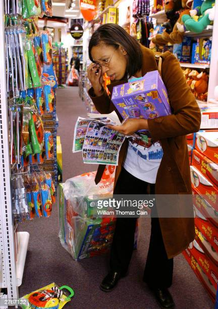 Erica Hiltreth of Norristown Pennsylvania does her Black Friday shopping at KB Toys which opened at 5am in the King of Prussia Mall November 28 2003...