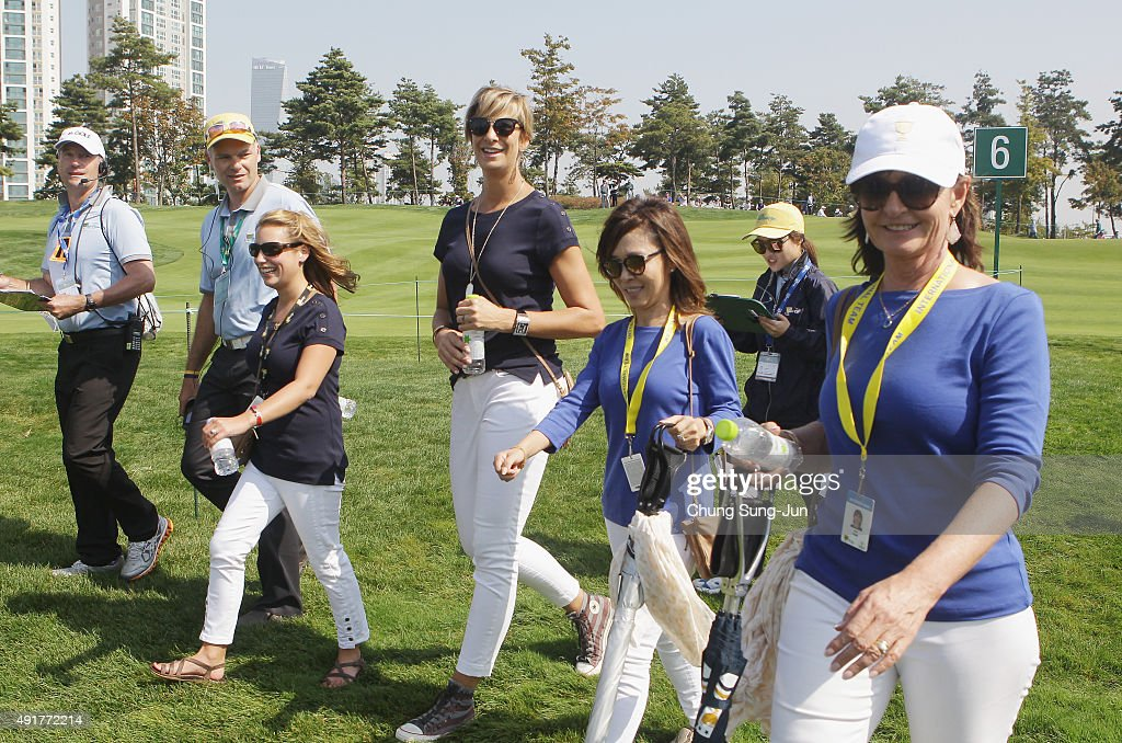 Erica Holmes and Angie Watson (L) walk alongside Kim Choi and Sue Price during the Thursday foursomes matches at The Presidents Cup at Jack Nicklaus Golf Club Korea on October 8, 2015 in Songdo IBD, Incheon City, South Korea