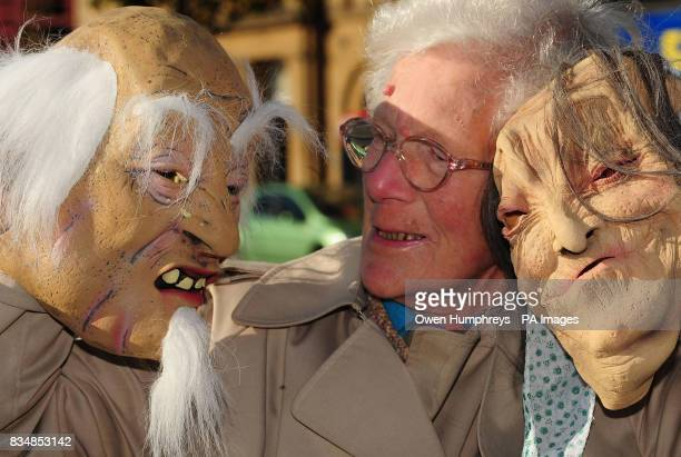 Erica Marston with two 'scary pensioner' masks on sale in Woolworthes which have been condemned as 'deeply inappropriate' and discriminating against...
