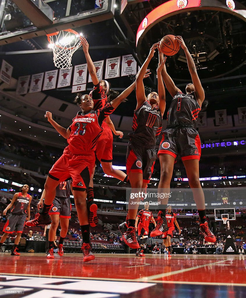 Erica McCall #11 and Jordan Reynolds #1 of the West rebound over Stephanie Mavunga #23 of the East during the 2013 McDonald's All American game at United Center on April 3, 2013 in Chicago, Illinois.