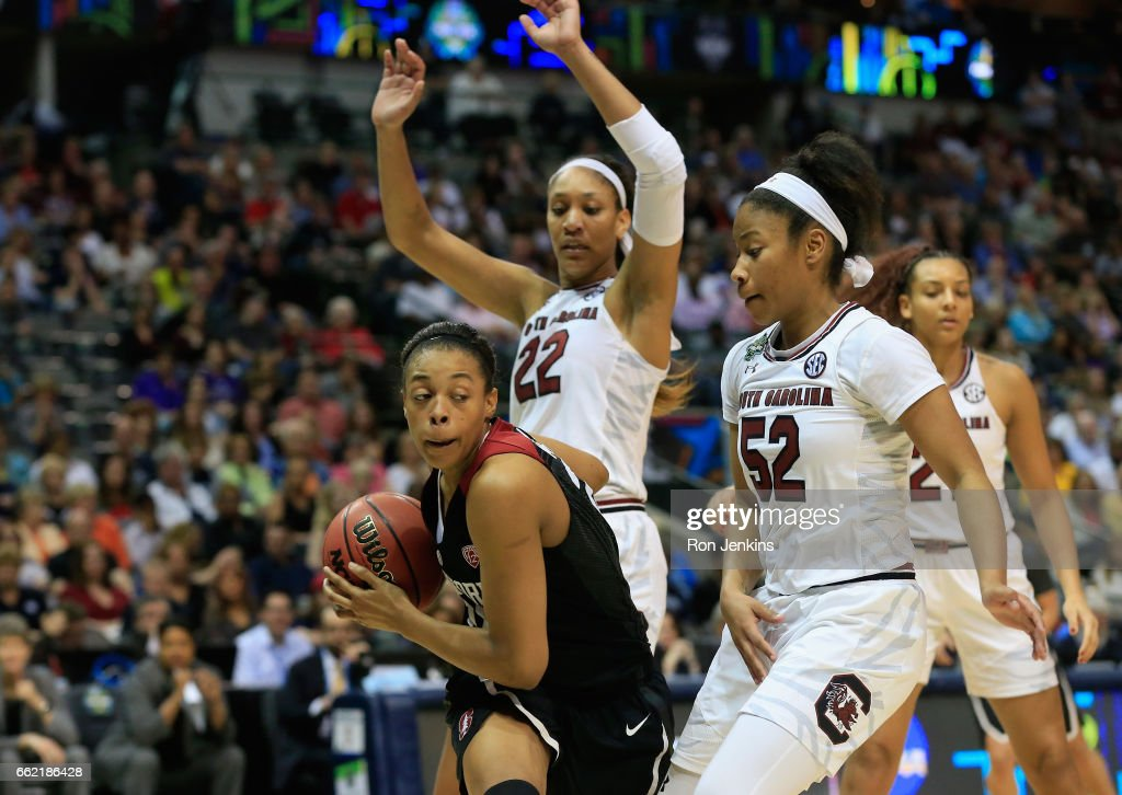Erica McCall #24 of the Stanford Cardinal drives against Tyasha Harris #52 and A'ja Wilson #22 of the South Carolina Gamecocks in the second half during the semifinal round of the 2017 NCAA Women's Final Four at American Airlines Center on March 31, 2017 in Dallas, Texas. The South Carolina Gamecocks won 62-53.