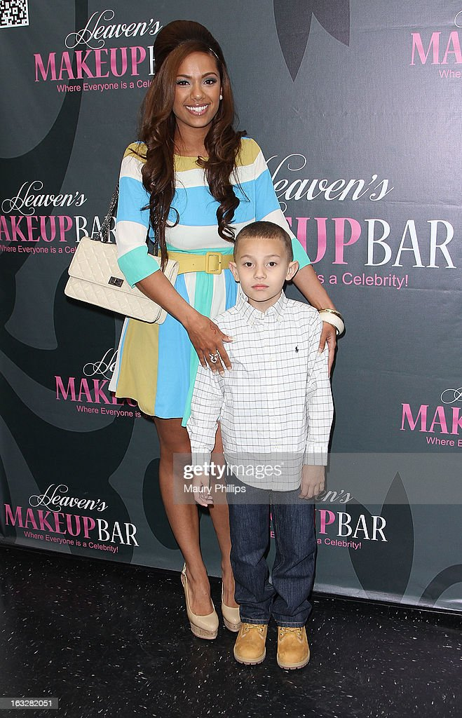 Erica Mena and her son King attend the launch party for VH1's 'Love & Hip Hop' Star Erica Mena new cosmetic line 'Lady J Cosmetics' at Heaven's Makeup Bar on March 6, 2013 in Burbank, California.
