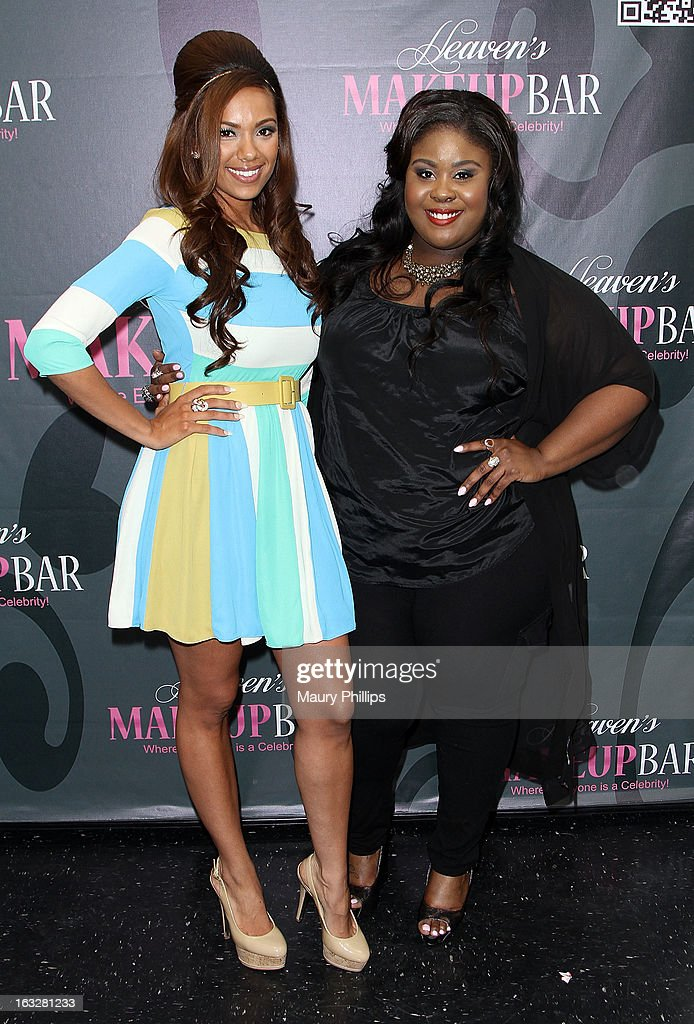 Erica Mena and Raven Goodwin attend the launch party for VH1's 'Love & Hip Hop' Star Erica Mena new cosmetic line 'Lady J Cosmetics' at Heaven's Makeup Bar on March 6, 2013 in Burbank, California.