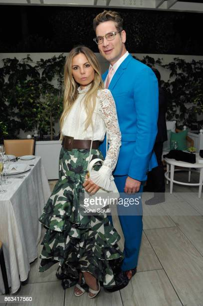 Erica Pelosini and Cameron Silver attend THE OUTNET x Amber Valletta at Waldorf Astoria Beverly Hills on October 19 2017 in Beverly Hills California