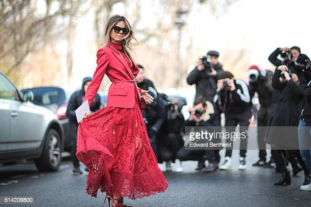 Erica Pelosini is wearing a red dress after the Giambattista Valli show during Paris Fashion Week Womenswear Fall Winter 2016/2017 on March 7 2016 in...