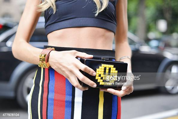 Erica Pelosini poses wearing a Balmain skirt Emilio Pucci top Hermes bracelet and Les Petits Joueurs clutch on June 20 2015 in Milan Italy