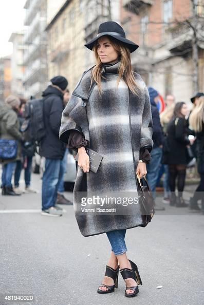 Erica Pelosini poses wearing a Ferragamo total look during day 3 of Milan Menswear Fashion Week Fall/Winter 2015/2016 on January 19 2015 in Milan...