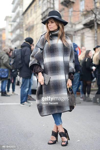 Erica Pelosini poses wearing a Ferragamo total look during day 3 of Milan Menswear Fashion Week Fall/Winter 2015/2016 on January 19 2015 in Milan...
