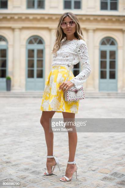 Erica Pelosini poses with a Bulgari bag after the Schiaparelli show at Place Vendome during Paris Fashion Week Haute Couture FW 17/18 on July 3 2017...