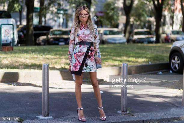 Erica Pelosini wearing a dress is seen outside Prada during Milan Men's Fashion Week Spring/Summer 2018 on June 18 2017 in Milan Italy