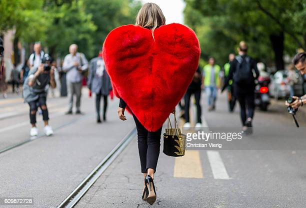 Erica Pelosini wearing a heart jacket outside Fendi during Milan Fashion Week Spring/Summer 2017 on September 22 2016 in Milan Italy