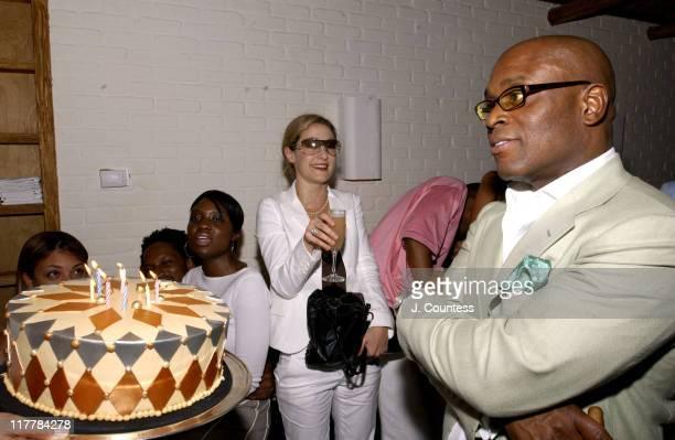 Erica Reid presents the birthday to Antonio 'LA' Reid