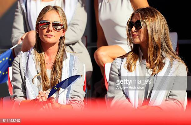 Erica Stoll and Eva Bossaerts look on during the 2016 Ryder Cup Opening Ceremony at Hazeltine National Golf Club on September 29 2016 in Chaska...