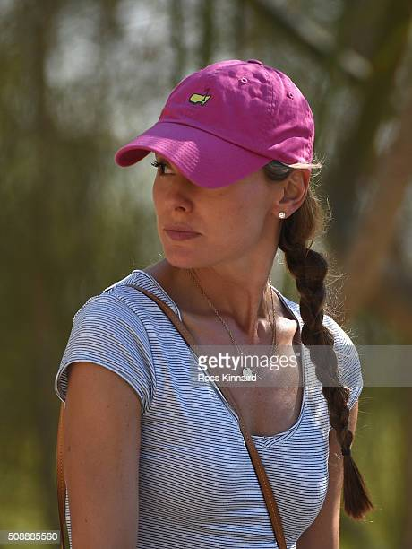 Erica Stoll fiancee of Rory McIlroy of Northern Ireland watches him play the 18th hole during the final round of the Omega Dubai Desert Classic at...