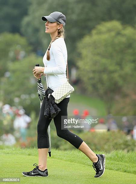 Erica Stoll follows the play of Rory McIlroy of Northern Ireland during the third round of the WGC HSBC Champions at the Sheshan International Golf...