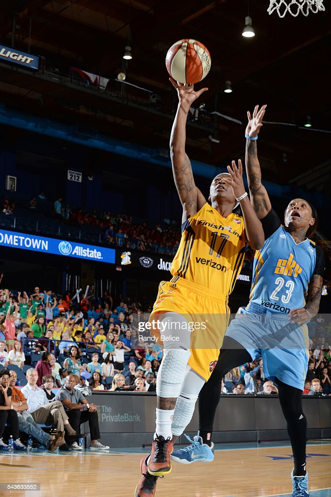 Erica Wheeler #17 of the Indiana Fever goes for a layup against <a gi-track='captionPersonalityLinkClicked' href=/galleries/search?phrase=Cappie+Pondexter&family=editorial&specificpeople=544600 ng-click='$event.stopPropagation()'>Cappie Pondexter</a> #23 of the Chicago Sky on June 29, 2016 at Allstate Arena in Rosemont, IL.