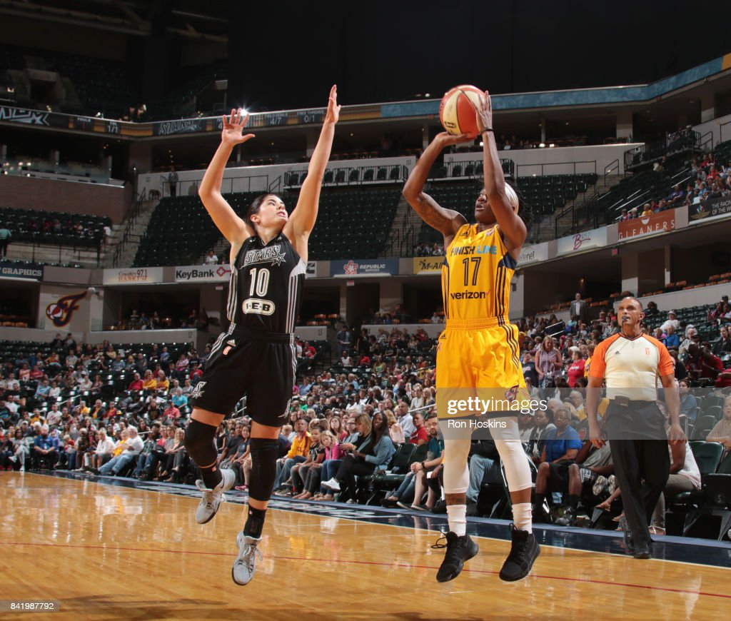 Erica Wheeler #17 of the Indiana Fever shoots the ball against Kelsey Plum #10 of the San Antonio Stars on September 2, 2017 at Bankers Life Fieldhouse in Indianapolis, Indiana.