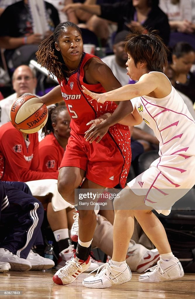 Erica White of the Houston Comets looks to maneuver against Yuko Oga of the Phoenix Mercury during the game on September 7 2008 at US Airways Center...