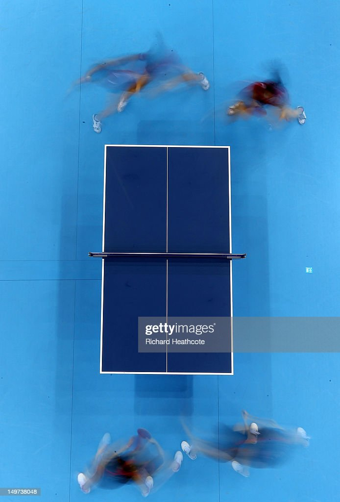 Erica Wu and Lily Zhang of the United States (top) in action against Kasumi Ishikawa and Ai Fukuhara of Japan in the first round of the Womens Team competition on Day 7 of the London 2012 Olympic Games at ExCeL on August 3, 2012 in London, England.
