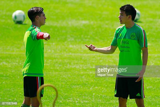 Erick Aguirre and Hirving Lozano of Mexico discuss during a training session ahead of the friendly match between Mexico and Argentina at CAR on July...