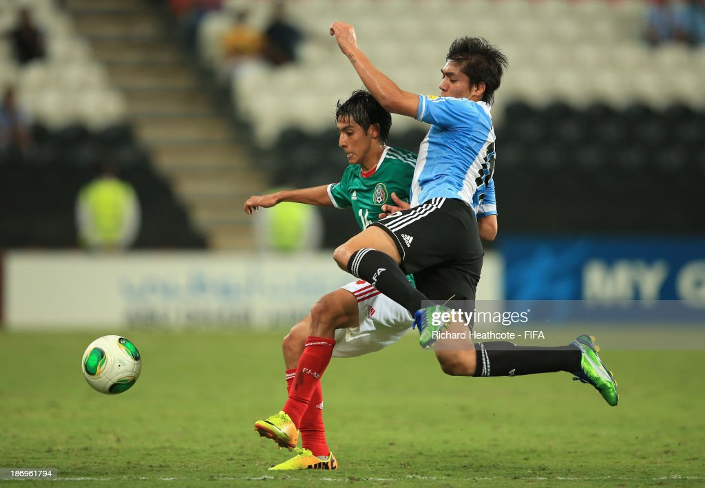 Erick Aguirre of Mexico battles with Franco Perez of Argentina during the FIFA U-17 World Cup UAE 2013 Semi Final match between Argentina and Mexico at the Mohamed Bin Zayed Stadium on November 5, 2013 in Abu Dhabi, United Arab Emirates.