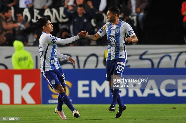 Erick Aguirre of Mexico´s Pachuca celebrates his goal with his teammate Jonathan Urretaviscaya against Belize´s Police United during their CONCACAF...