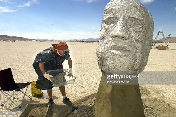 Erick Alschuler an artist from San Francisco finishes his work at Black Rock City during the Burning Man festival in Nevada 01 September 1999...