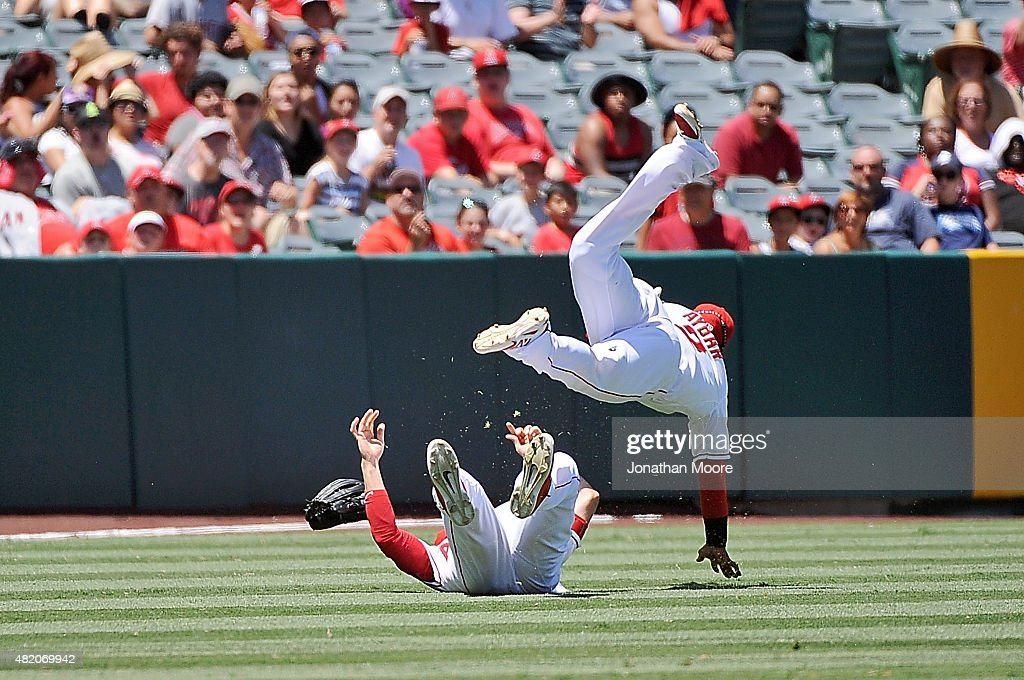 Erick Aybar #2 and Matt Joyce #20 of the Los Angeles Angels of Anaheim collide while trying to catch a fly ball in the fourth inning during a game against the Texas Rangers at Angel Stadium of Anaheim on July 26, 2015 in Anaheim, California.