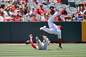 Erick Aybar and Matt Joyce of the Los Angeles Angels of Anaheim collide while trying to catch a fly ball in the fourth inning during a game against...