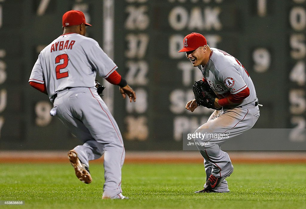 <a gi-track='captionPersonalityLinkClicked' href=/galleries/search?phrase=Erick+Aybar&family=editorial&specificpeople=551376 ng-click='$event.stopPropagation()'>Erick Aybar</a> #2 and <a gi-track='captionPersonalityLinkClicked' href=/galleries/search?phrase=Mike+Trout&family=editorial&specificpeople=7091306 ng-click='$event.stopPropagation()'>Mike Trout</a> #27 of the Los Angeles Angels of Anaheim celebrate a 4-3 win against the Boston Red Sox at Fenway Park on August 19, 2014 in Boston, Massachusetts.