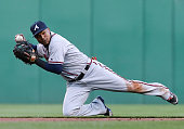 Erick Aybar of the Atlanta Braves attempts a throw from his knees in the first inning during the game against the Pittsburgh Pirates at PNC Park on...