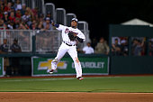 Erick Aybar of the Atlanta Braves makes a jump throw to first base but is unable to get the out during the game against the Miami Marlins at Fort...