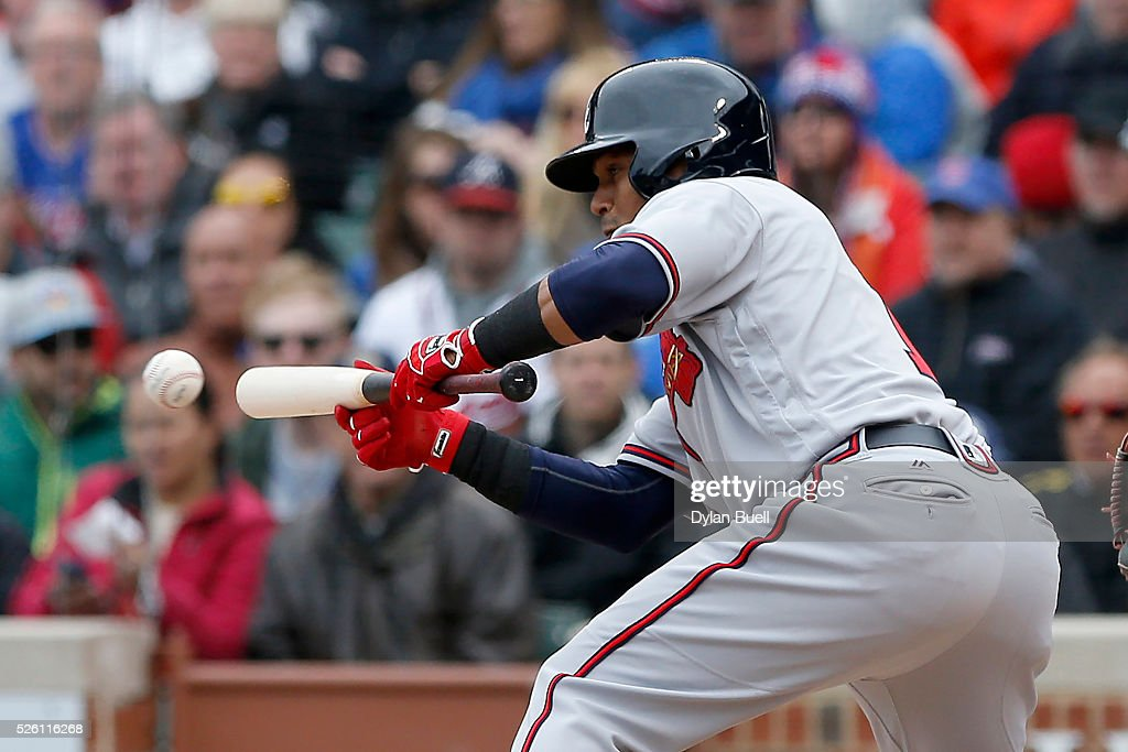 <a gi-track='captionPersonalityLinkClicked' href=/galleries/search?phrase=Erick+Aybar&family=editorial&specificpeople=551376 ng-click='$event.stopPropagation()'>Erick Aybar</a> #1 of the Atlanta Braves reaches on a bunt single in the seventh inning against the Chicago Cubs at Wrigley Field on April 29, 2016 in Chicago, Illinois.