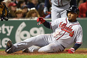 Erick Aybar of the Atlanta Braves slides into home in the fourth inning during the game against the Boston Red Sox at Fenway Park on April 28 2016 in...