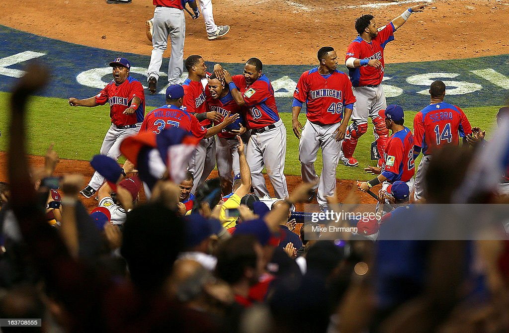 <a gi-track='captionPersonalityLinkClicked' href=/galleries/search?phrase=Erick+Aybar&family=editorial&specificpeople=551376 ng-click='$event.stopPropagation()'>Erick Aybar</a> #2 of the Dominican Republic celebrates after scoring the go ahead run during a World Baseball Classic second round game against the USA at Marlins Park at Marlins Park on March 14, 2013 in Miami, Florida.
