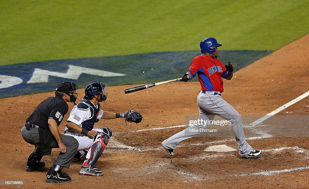 <a gi-track='captionPersonalityLinkClicked' href=/galleries/search?phrase=Erick+Aybar&family=editorial&specificpeople=551376 ng-click='$event.stopPropagation()'>Erick Aybar</a> #2 of the Dominican Republic hits during a World Baseball Classic second round game against the USA at Marlins Park at Marlins Park on March 14, 2013 in Miami, Florida.