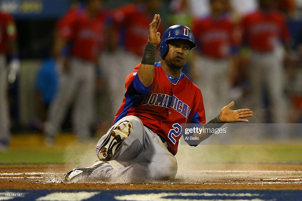 <a gi-track='captionPersonalityLinkClicked' href=/galleries/search?phrase=Erick+Aybar&family=editorial&specificpeople=551376 ng-click='$event.stopPropagation()'>Erick Aybar</a> #2 of the Dominican Republic slides into home against Puerto Rico during the first round of the World Baseball Classic at Hiram Bithorn Stadium on March 10, 2013 in San Juan, Puerto Rico.