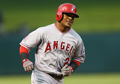 Erick Aybar of the Los Angeles Angels hits a homerun against the Texas Rangers in the second inning at Globe Life Park in Arlington on September 11...