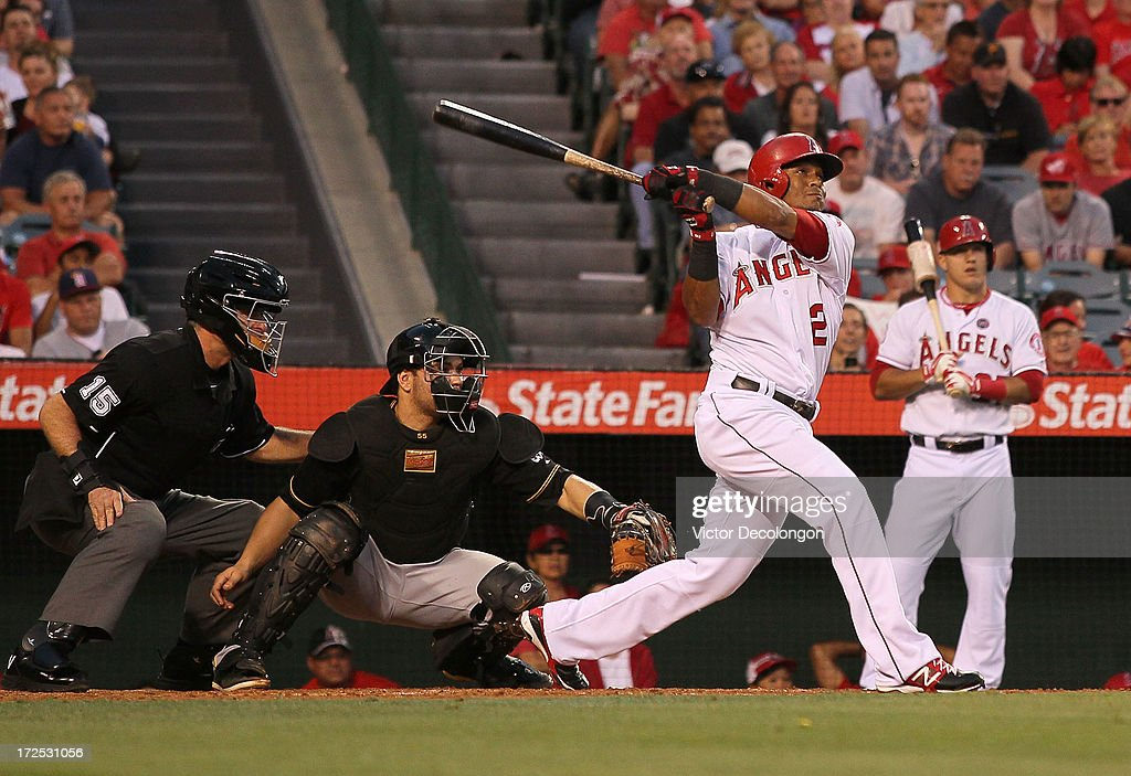 <a gi-track='captionPersonalityLinkClicked' href=/galleries/search?phrase=Erick+Aybar&family=editorial&specificpeople=551376 ng-click='$event.stopPropagation()'>Erick Aybar</a> #2 of the Los Angeles Angels of Anaheim bats in the third inning during the MLB game against the Pittsburgh Pirates at Angel Stadium of Anaheim on June 21, 2013 in Anaheim, California. The Pirates defeated the Angels 5-2.