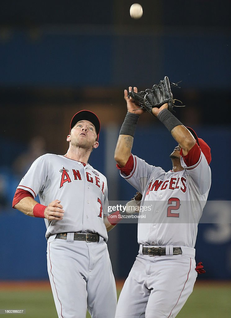 <a gi-track='captionPersonalityLinkClicked' href=/galleries/search?phrase=Erick+Aybar&family=editorial&specificpeople=551376 ng-click='$event.stopPropagation()'>Erick Aybar</a> #2 of the Los Angeles Angels of Anaheim catches a pop up in the seventh inning as he calls off <a gi-track='captionPersonalityLinkClicked' href=/galleries/search?phrase=Andrew+Romine&family=editorial&specificpeople=2338123 ng-click='$event.stopPropagation()'>Andrew Romine</a> #7 during MLB game action against the Toronto Blue Jays on September 10, 2013 at Rogers Centre in Toronto, Ontario, Canada.
