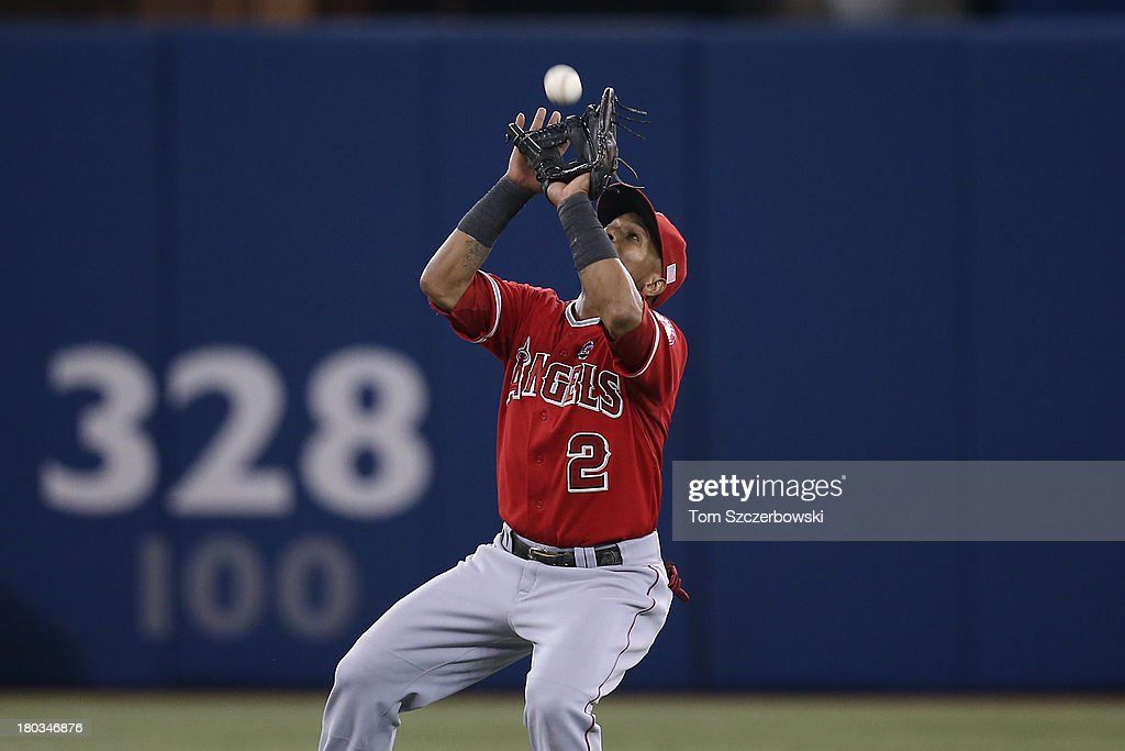 <a gi-track='captionPersonalityLinkClicked' href=/galleries/search?phrase=Erick+Aybar&family=editorial&specificpeople=551376 ng-click='$event.stopPropagation()'>Erick Aybar</a> #2 of the Los Angeles Angels of Anaheim catches a pop up in the ninth inning during MLB game action against the Toronto Blue Jays on September 11, 2013 at Rogers Centre in Toronto, Ontario, Canada.