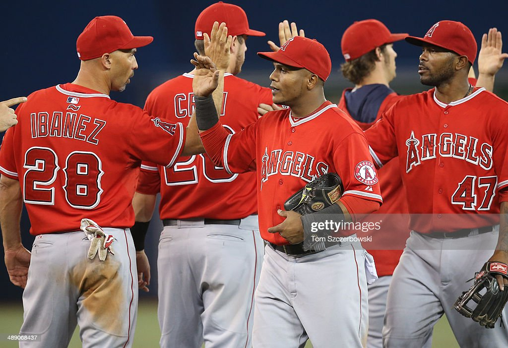 Erick Aybar #2 of the Los Angeles Angels of Anaheim celebrates a victory with Raul Ibanez #28 during MLB game action against the Toronto Blue Jays on May 9, 2014 at Rogers Centre in Toronto, Ontario, Canada.