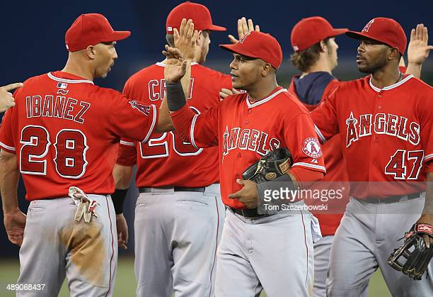 Erick Aybar of the Los Angeles Angels of Anaheim celebrates a victory with Raul Ibanez during MLB game action against the Toronto Blue Jays on May 9...