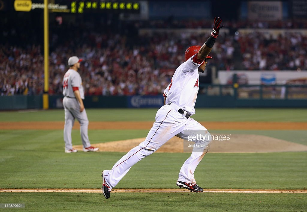 <a gi-track='captionPersonalityLinkClicked' href=/galleries/search?phrase=Erick+Aybar&family=editorial&specificpeople=551376 ng-click='$event.stopPropagation()'>Erick Aybar</a> #2 of the Los Angeles Angels of Anaheim celebrates his walk off single against the St. Louis Cardinals in the ninth inning at Angel Stadium of Anaheim on July 4, 2013 in Anaheim, California. The Angels defeated the Cardinals 6-5.