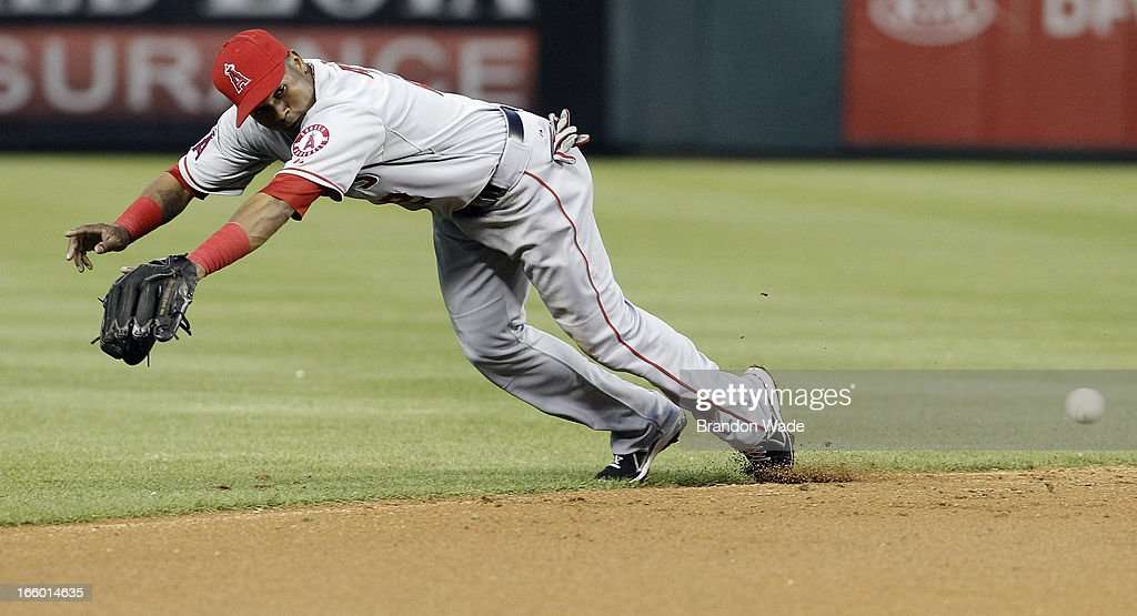 <a gi-track='captionPersonalityLinkClicked' href=/galleries/search?phrase=Erick+Aybar&family=editorial&specificpeople=551376 ng-click='$event.stopPropagation()'>Erick Aybar</a> #2 of the Los Angeles Angels of Anaheim dives for a grounder hit by <a gi-track='captionPersonalityLinkClicked' href=/galleries/search?phrase=Ian+Kinsler&family=editorial&specificpeople=538104 ng-click='$event.stopPropagation()'>Ian Kinsler</a> #5 of the Texas Rangers, not pictured, in the second inning of a baseball game at Rangers Ballpark in Arlington on April 7, 2013 in Arlington, Texas. Aybar was unable to catch the ball. Texas won 7-3.