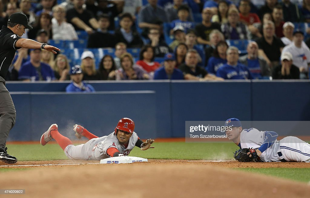 <a gi-track='captionPersonalityLinkClicked' href=/galleries/search?phrase=Erick+Aybar&family=editorial&specificpeople=551376 ng-click='$event.stopPropagation()'>Erick Aybar</a> #2 of the Los Angeles Angels of Anaheim evades the tag of <a gi-track='captionPersonalityLinkClicked' href=/galleries/search?phrase=Josh+Donaldson&family=editorial&specificpeople=4959442 ng-click='$event.stopPropagation()'>Josh Donaldson</a> #20 of the Toronto Blue Jays to arrive safely at third base in the eighth inning during MLB game action on May 19, 2015 at Rogers Centre in Toronto, Ontario, Canada.